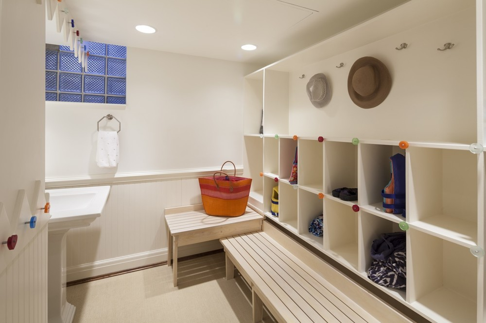 We used colorful cabinet hardware as a decorative element throughout this poolhouse changing room so no one would lack a fun spot to hang a damp towel.