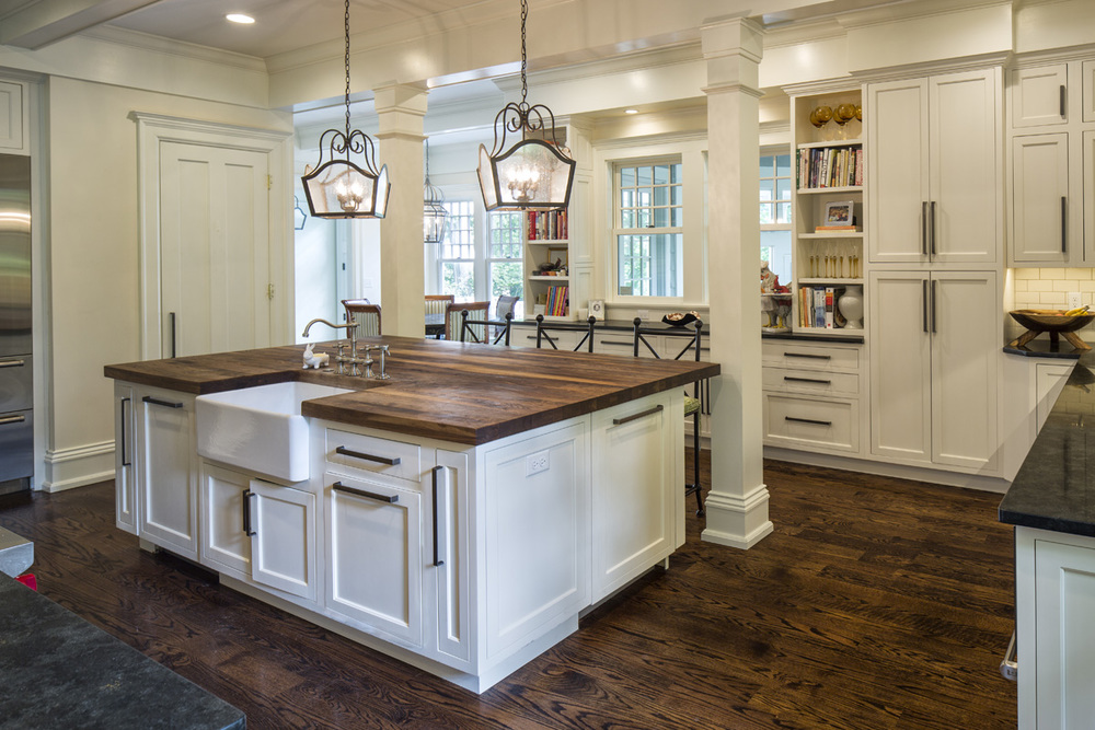 Infinite, intricate details delivered on our clients' dreams for an intimate yet ample kitchen to accommodate their family of seven who digs cooking together. The island is custom-made Alderwood butcher block with an ogee edge.