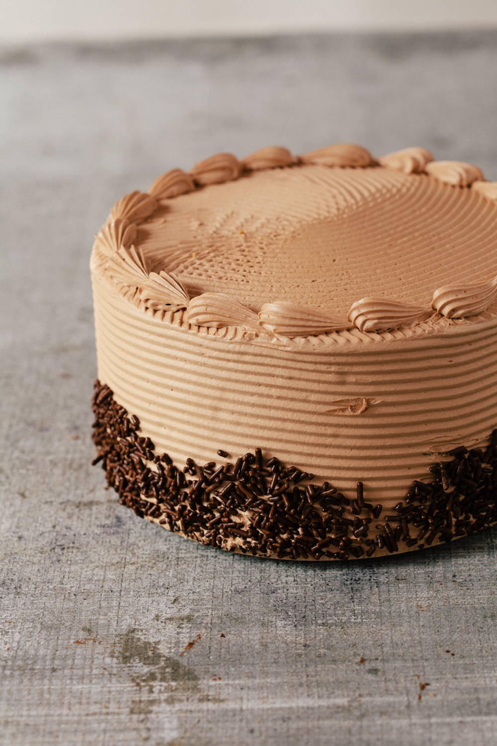 "Devil's Food Cake: Three layers of moist dense devil's food cake with chocolate buttercream. Available daily in 7"" round."