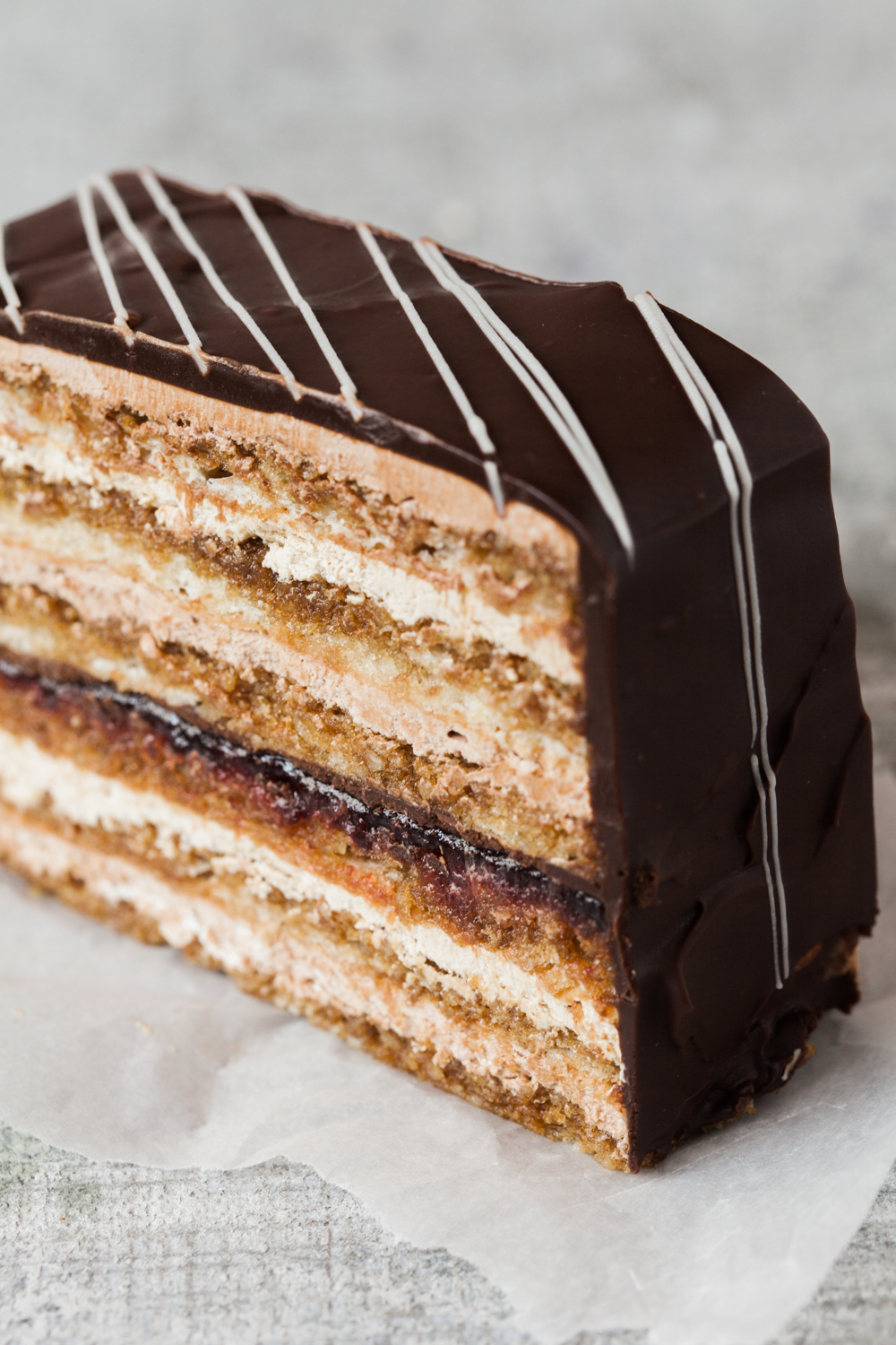 Clichy: This is a seven layer coffee brushed biscuit, layered with coffee and chocolate buttercream, a hint of raspberry, covered in ganache.  The clichy can also be ordered as a cake to feed 6 to 8 people.