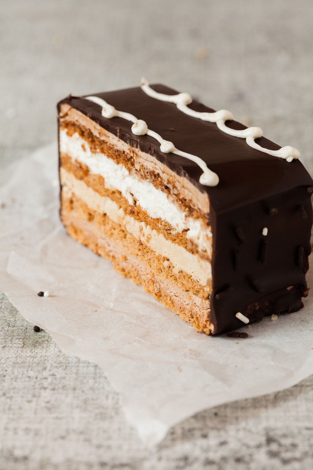 Marjolaine:  This wonderful pastry has four layers of crispy hazelnut meringue sandwiched with praline and chocolate buttercream, whipped cream, and covered in ganache. The Marjolaine can also be ordered in a cake form to feed 6 to 8 people.   *Gluten Free, Kosher for Passover