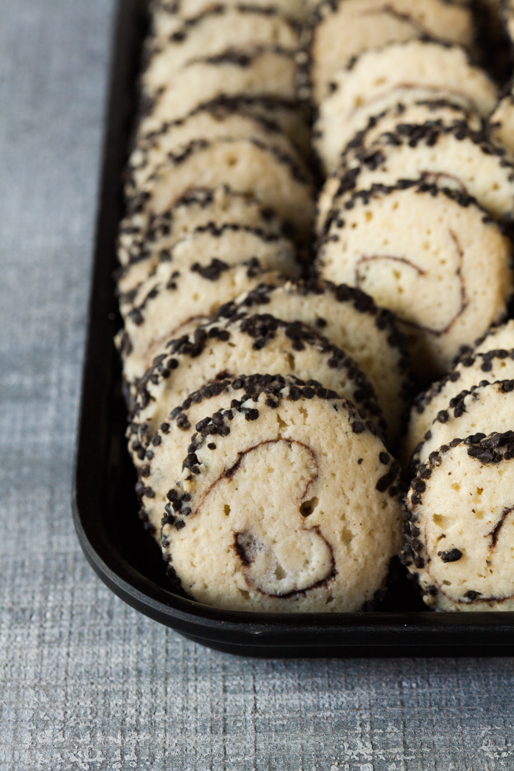 Chinese Cookie:  Shortbread cookie rolled with chocolate ganache in the center and chocolate sprinkles on the outside.