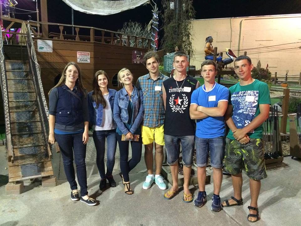 Ukrainian students in Virginia Beach took a night off to mini-golf with ERDT Work & Travel Program director Emily Reppun (at left).