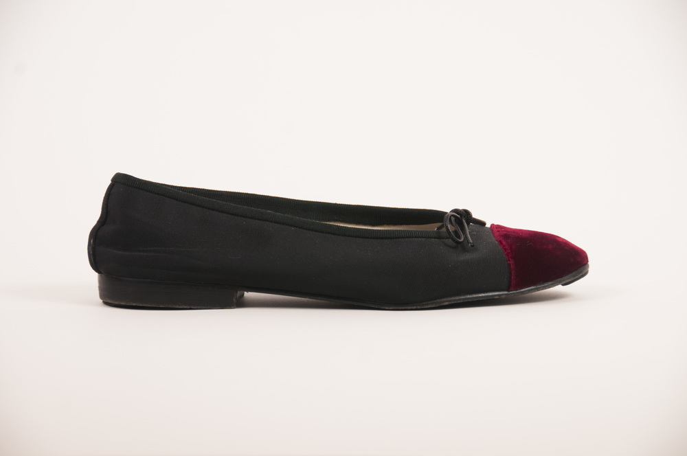 In my shop I focus on selling primarily high-end items, like these vintage red velvet Chanel flats. I do incorporate a few less expensive items as well. You will decide what niche your own vintage shop fills.