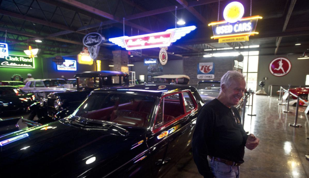 Jim Remlinger talks about the cars that will be up for auction next weekend while standing next to his collection of cars at Remlinger's Muscle Cars — where the auction will be held.  Chuck Miller, Winona Daily News