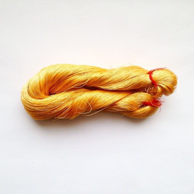 Gold zari thread made from electroplated copper wire, India