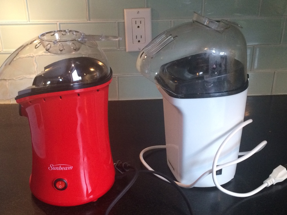 Both of these popcorn makers suck. ( At least the outlet behind them works .)