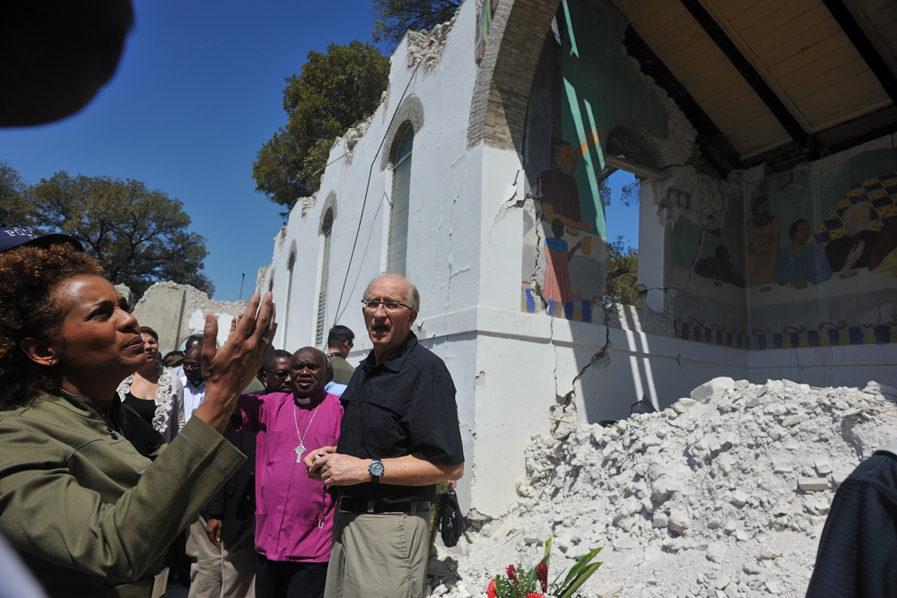 Their Excellencies visit locations in Port-au-Prince including the Cathédrale Épiscopale and the Sainte-Trinité school.