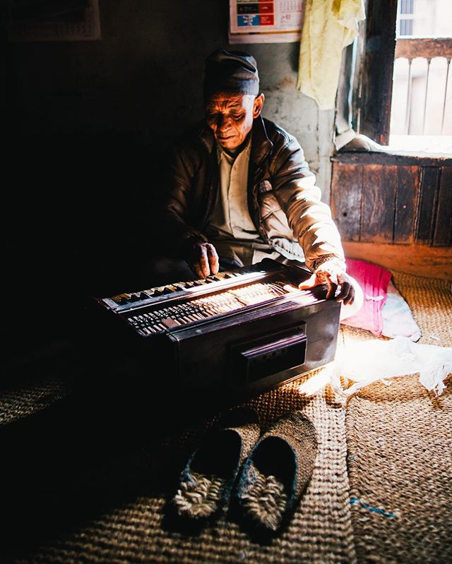 An absolute gent plays his harmonium on the third floor of his family's centuries-old home in the village of Bungamati, Nepal. This is a B-Side of my fave photo ever, which I took just prior to the Nepal's earthquakes in 2015.
