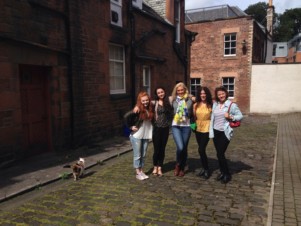 The girls on our quaint cobblestone street.