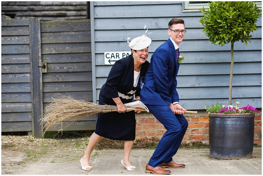 Groom and mother in law on broomstick