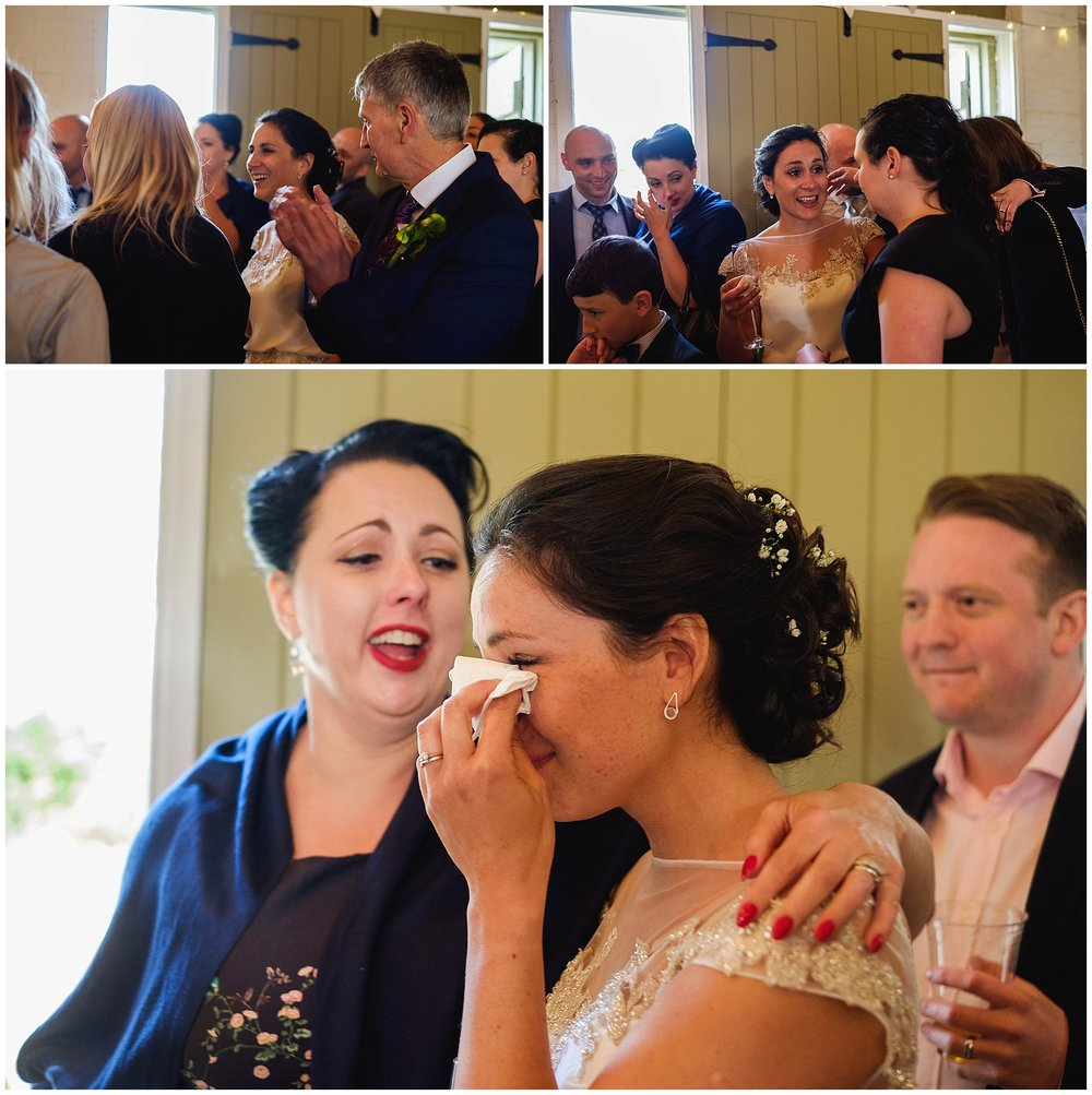 Bride cries as groom sings to her