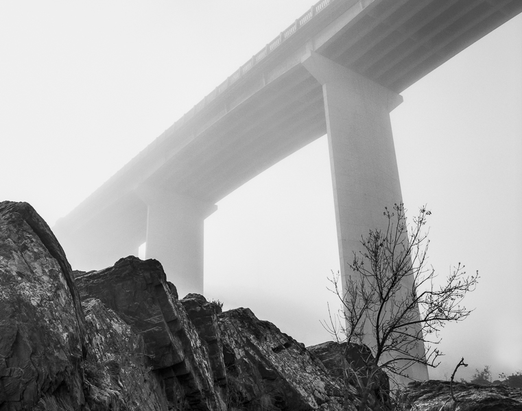 Rock and Bridge in Fog