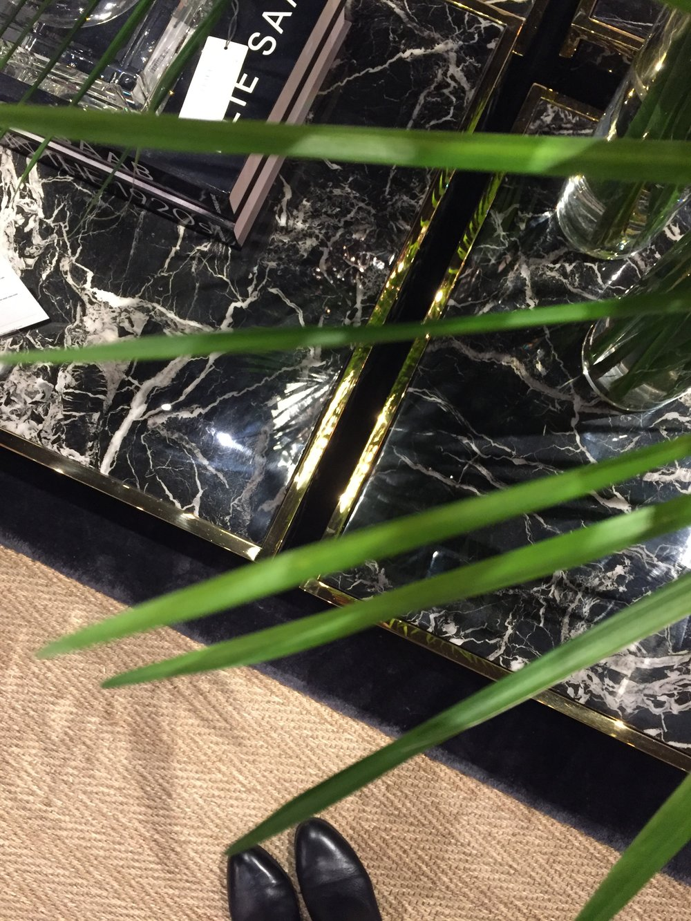 Glamorous details from Eichholtz. Love the black marble finish on these coffee tables.