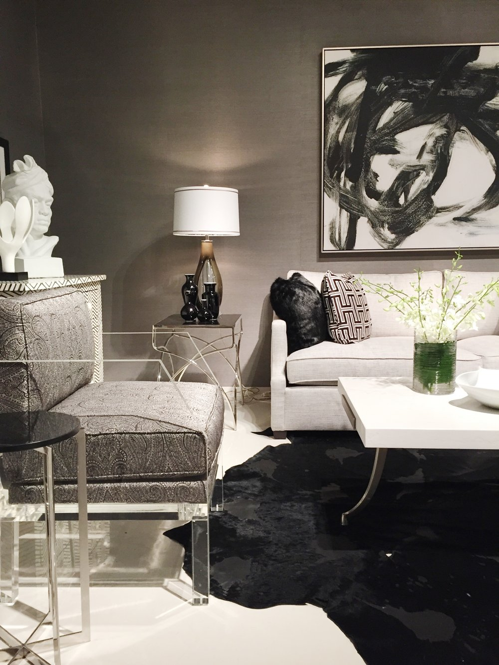 White couch. Black rug. In love with this room and this side chair with lucite legs and a classic black & white damask by  Bernhardt