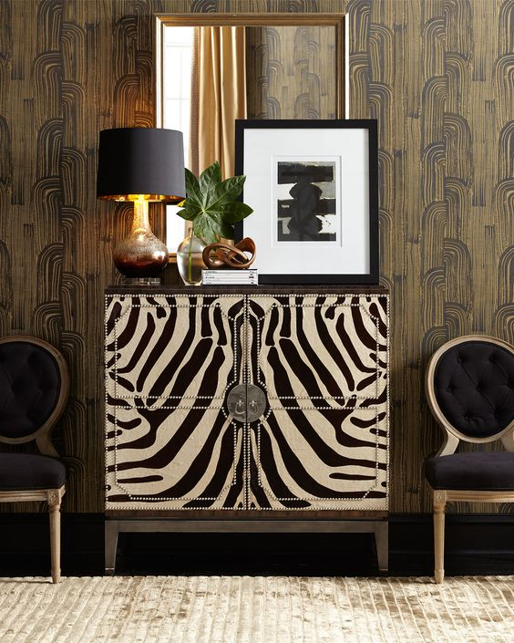Kelly Wearstler wallpaper adds the perfect background to this zebra chest