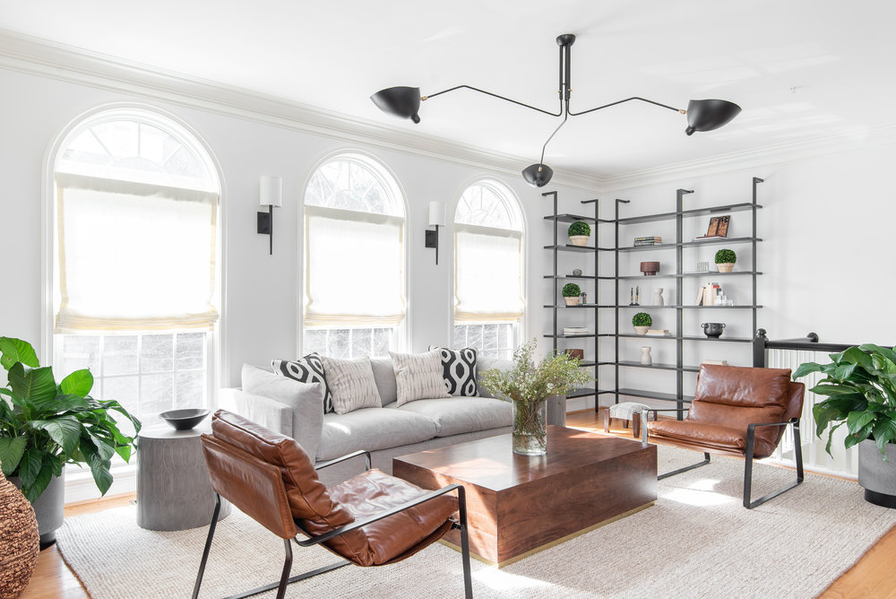 living-room-decoration-bethesda-md-washington-dc-dmv-homes-wood-table-gray-sofa-family-room-kid-friendly-mid-century-modern-chandelier-black-and-white-design-bookshelves-wall-splendor-styling-mariella-cruzado-designer-dmv.jpg