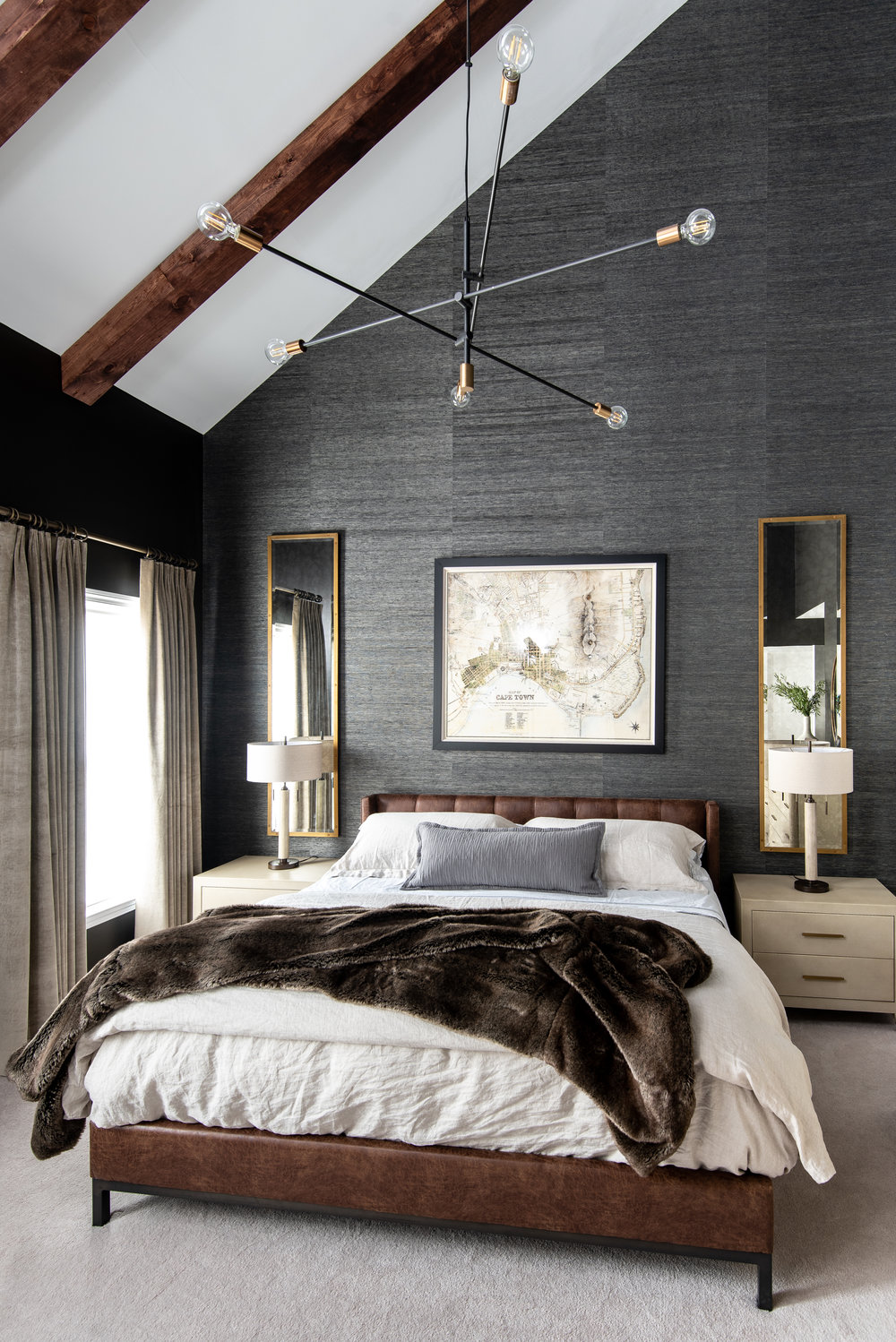 beams-master-bedroom-dark-walls-leather-bed-tall-mirrors-reading-nook-tufted-chair-faux-fur-mobile-chandelier-bethesda-dmv-homes-splendor-styling.jpg