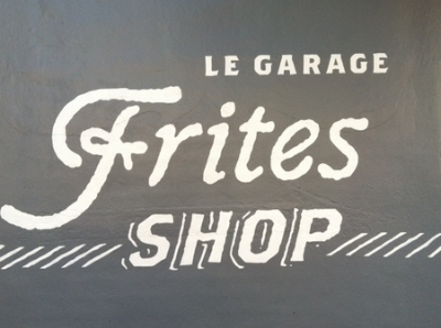 Le Garage - 911 W 36th Street Stop here for gourmet fries, french treates and full bar Turn right