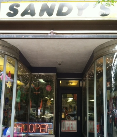 Sandy's Bargain Center - 1029 W 36th Street Stop here for gifts, sports jerseys, memorabilia, and toys Turn right
