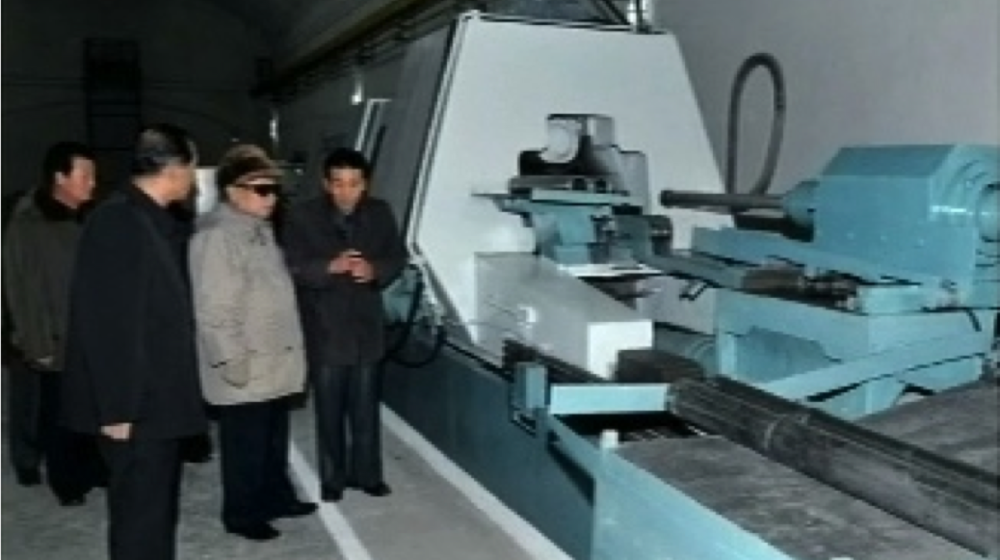 An example of the open-source evidence used for Kemp's study: A 2011 image from a television broadcast in North Korea showing Kim-Jong Il inspecting a flow-forming machine located in an underground tunnel. This type of machine is able to produce centrifuge rotors for North Korea's uranium-enrichment program.
