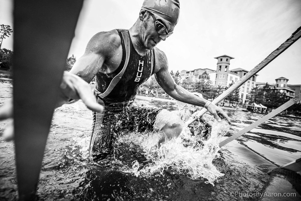 Photo Credit: Aaron Palaian. Exiting the swim in 52:21.