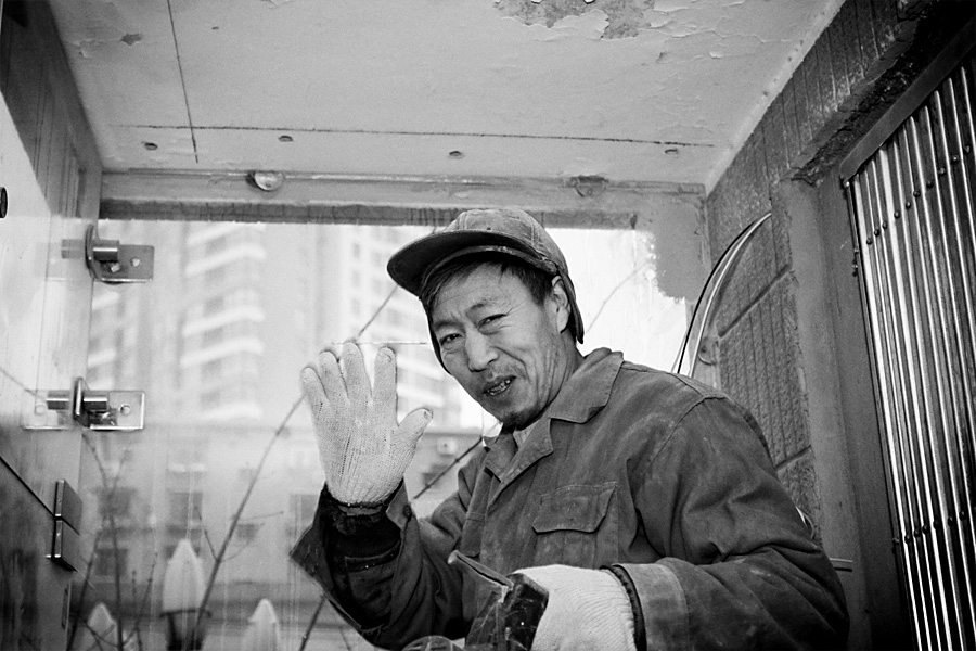 Mr. Wang, father of three children, born in BaZhong county, SiChuan, 1965. In 2006 he brought his wife and 11-year-old son to Beijing. His son Bai Cheng takes classes in a middle school dedicated to migrant workers. His wife, XiuLan works as a house cleaner. Life is tough in the city but they are happy and satisfied.
