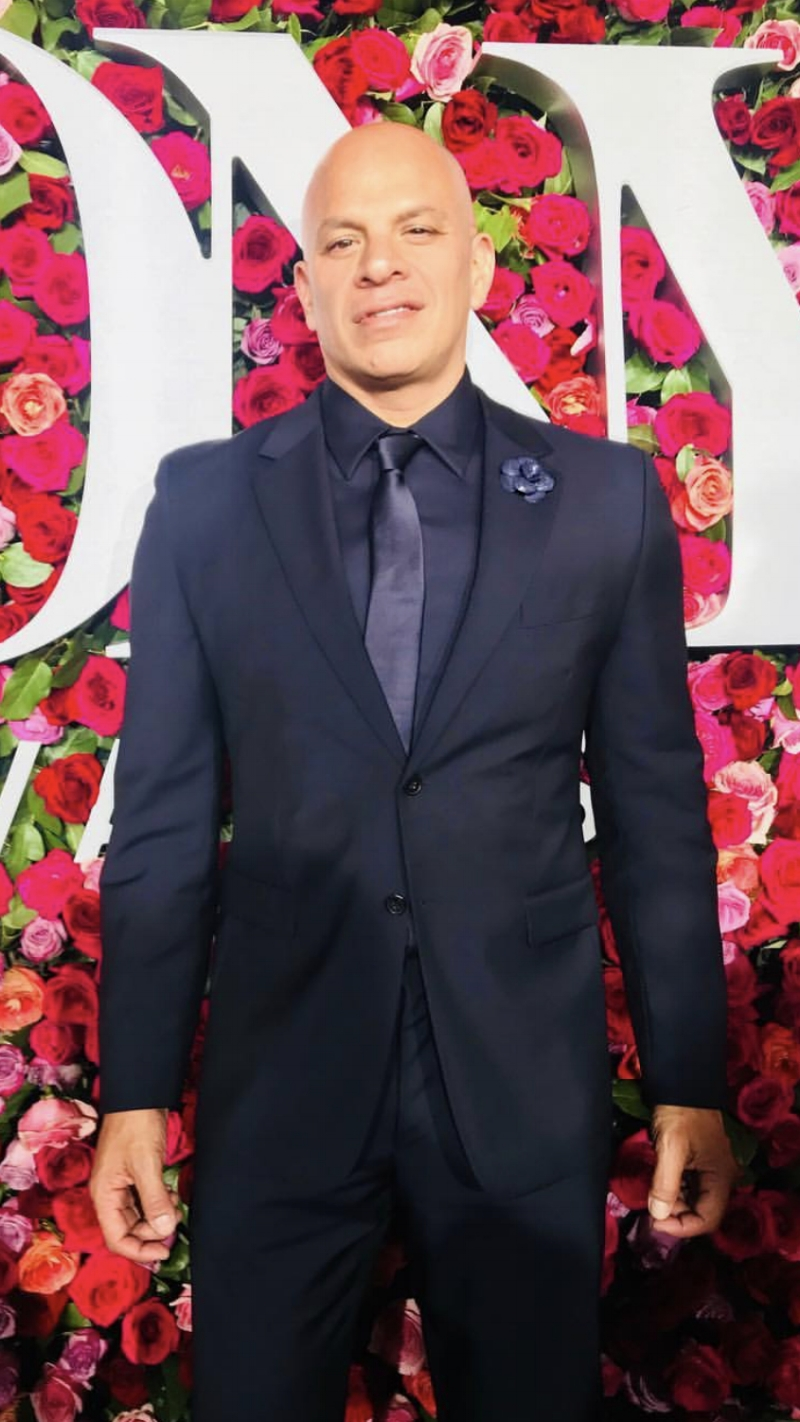 Broadway talent manager Mark Subias wears Fleur'd Pins Matte Navy Python Camellia to the 2018 TONY Awards at Radio City Music Hall.jpg
