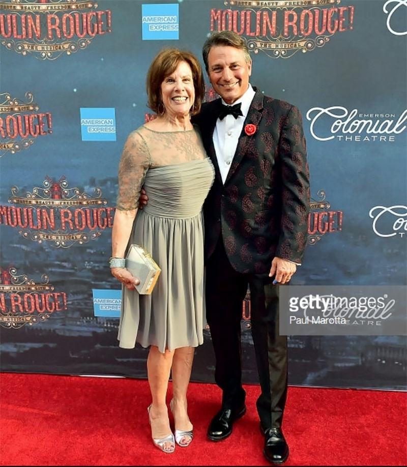 Ambassador Theatre Group CEO of North America Stephen Lewin and Debbie Lewin arrive at the gala performance of %22Moulin Rouge! The Musical%22 at Emerson Colonial Theatre on July 29, 2018 wearing Fleur'd Pins.jpg