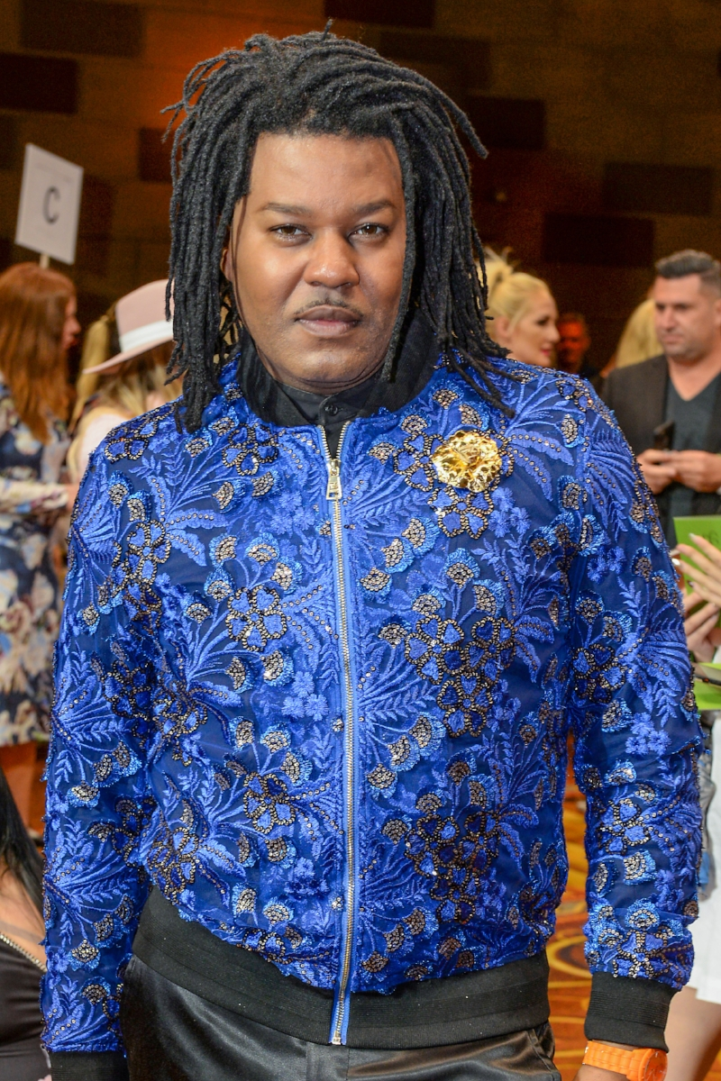 Stylist Ty-Ron Mayes wears Fleur'd Pins Gold Python Gardenia to Christian Siriano SS19 - photo by Andrew Werner .jpg
