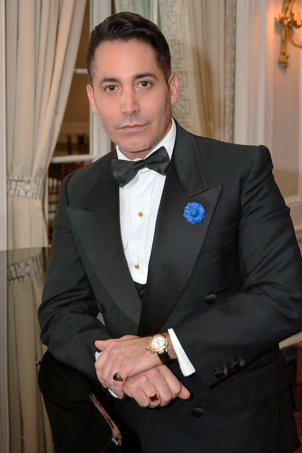 Celebrity Hairstylist Marco Marangello wears Fleur'd Pins' Royal Blue Mini Leather Gardenia in NYC.jpg