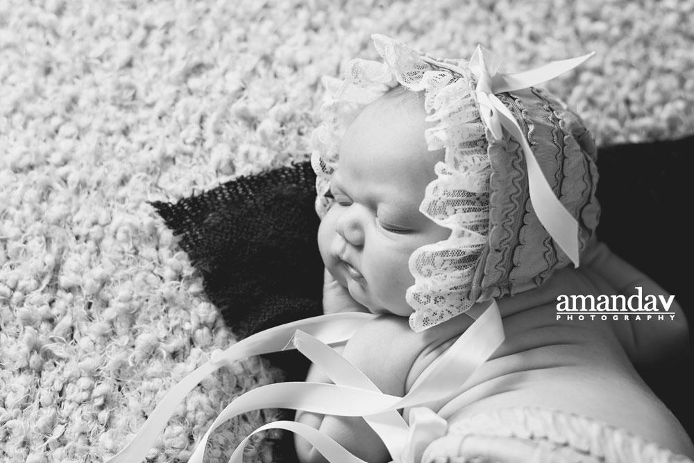 black and white newborn in studio