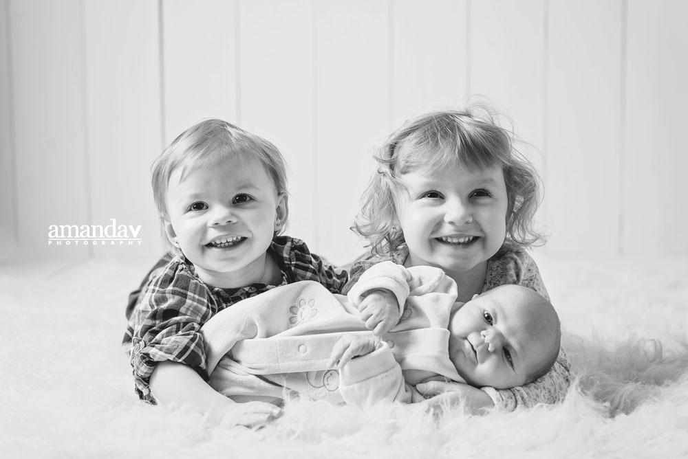 newborn with siblings in studio
