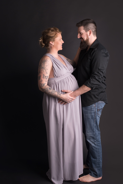 couple in studio for maternity session