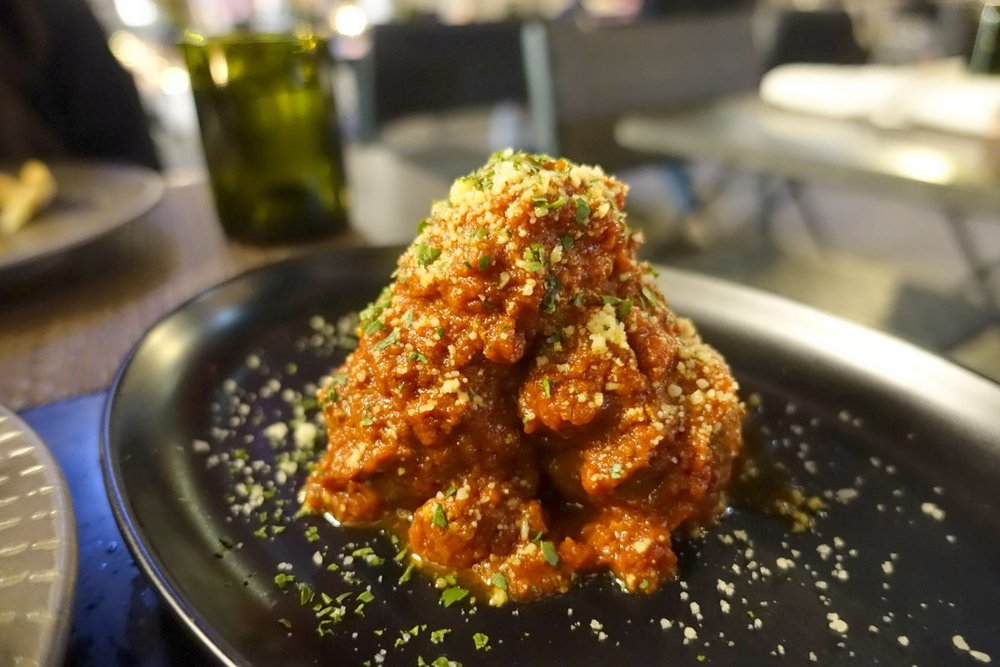 An extreamly generous portion of meatballs, juicy and flavorful.