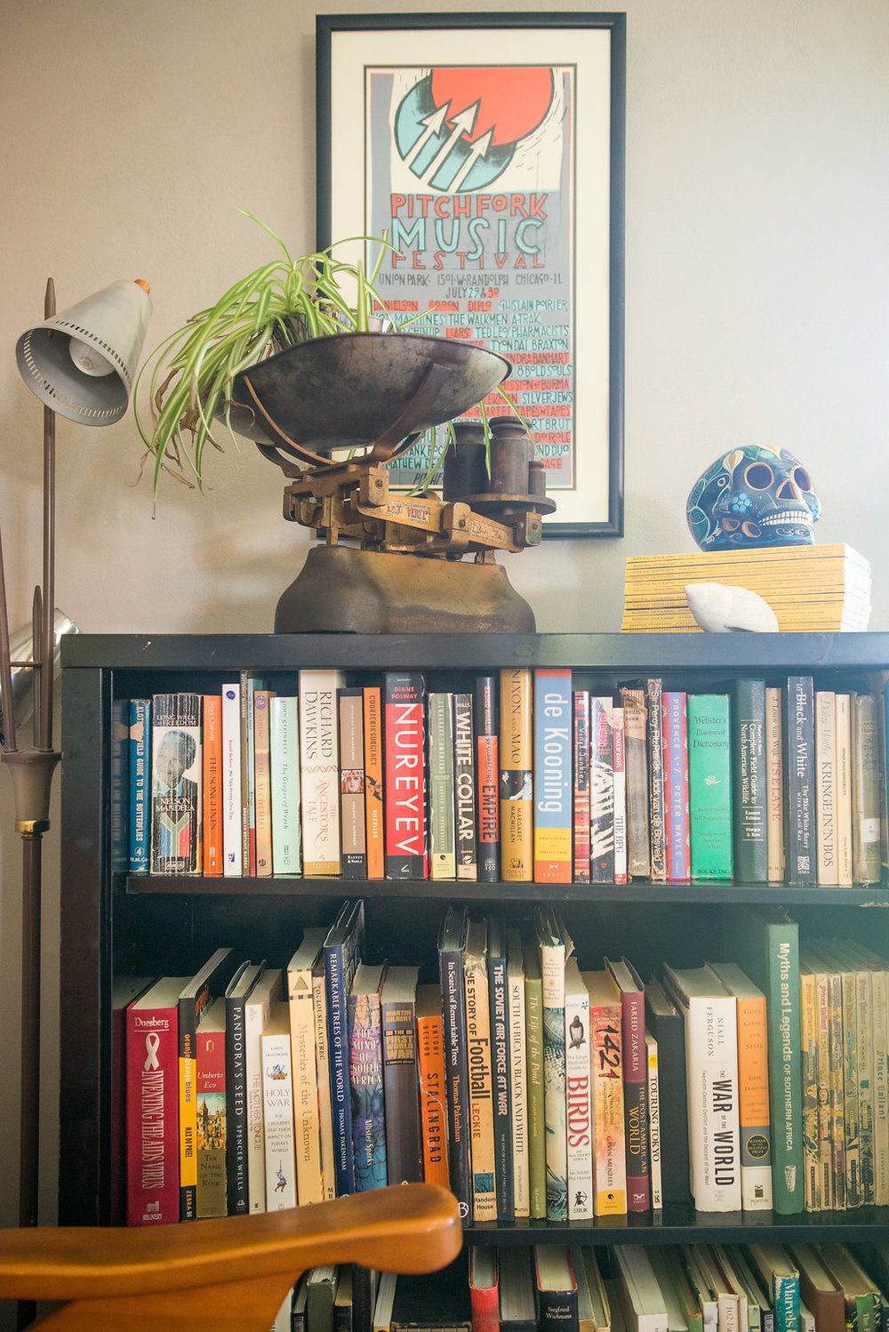"The scale moved with us when we came over.  The skull came from Santa Fe.  The festival poster was given to us by one of our Peace Corps friends (remember, Kate?) and the books we've both been acquiring since we got here.  Ask me about my ""Birds"" book."