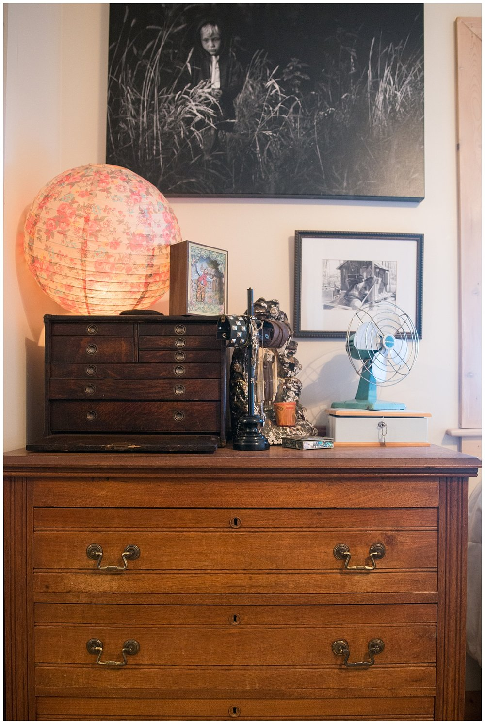There above the beautiful wooden dresser is a younger Tharin walking through a field.  The Chinese lantern is one of the first things Tytia bought from Fresh Digs.  It's always fun to see what she picks out from both the new stuff and the vintage stuff.