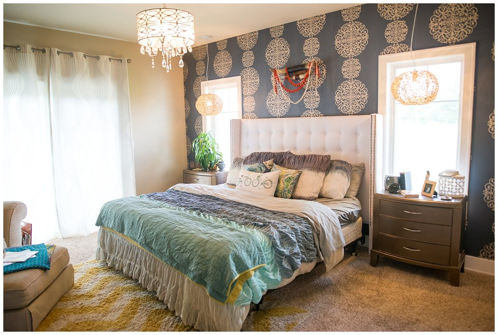 On to her bedroom.  Salina and Roy made the tufted headboard themselves.  The short shag rug is from Fresh Digs as is the vintage bull horn rack above the bed.  Two natural round lights hang above the bedside tables and another fantastic light hangs above.  And how about that wallpaper?