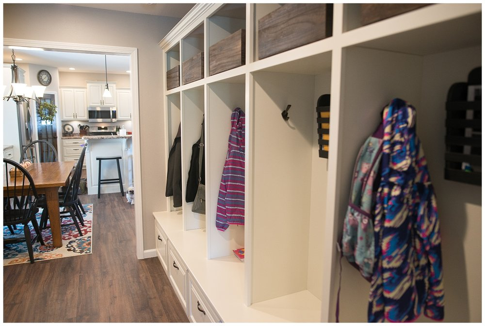 """Check out that storage!In order to tame household clutter Elizabeth had a local builder create a cubby for each family member. The racks came from Etsy. She says she often tells the kids to """"clean out your locker"""". : )"""