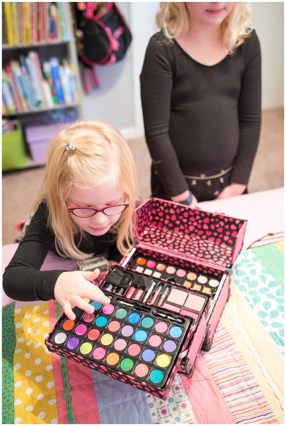 Tess's favorite thing is her brightly colored makeup kit and Lily's is, well, her makeup kit, albeit a little less bright.