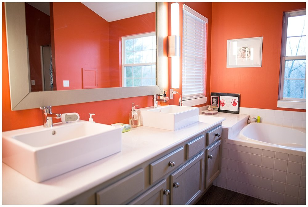 How fabulous is this?  Clean lines and a nice bold color.  They recently redid the bathroom and she says yes, she actually uses the tub.