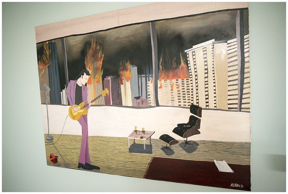 The painting on the wall was painted by a friend.  It's Darryl Hall of the group Hall and Oates playing the guitar while Chicago burns.