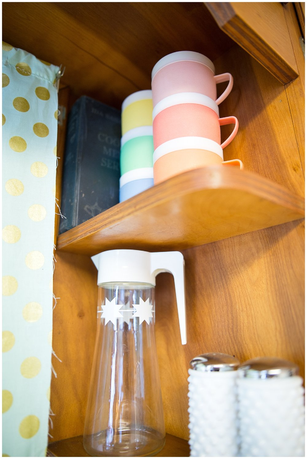 She adds fun color to her kitchen with the set of colorful vintage plasticware cups she got from Fresh Digs.  The hobnail salt and pepper shakers were a fantastic garage sale score.