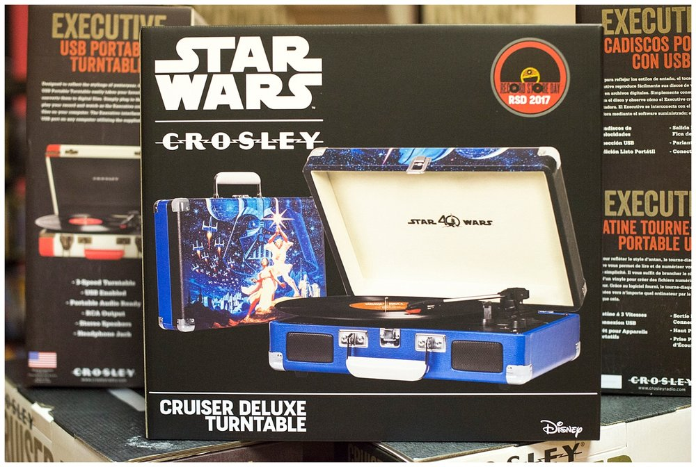 This is pretty exciting for all you Star Wars and vinyl fans.  Might be a great gateway table for young people, too.  Aaron can only start selling these Star Wars turntables on Record Store Day.  So many rules, but so exciting!