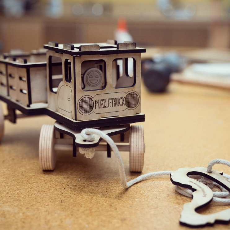 A wooden puzzle truck for an Indiegogo campaign