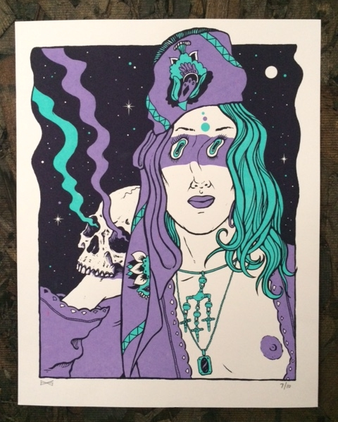 3 color screen printed black light poster in regular light.