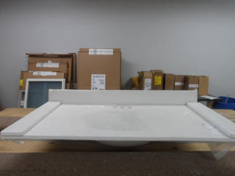 "Counter 6: 42 1/2"" x 22"" White/White cultured marble vanity top with left and right splash. Both ends are raw/cut.  $65.00"
