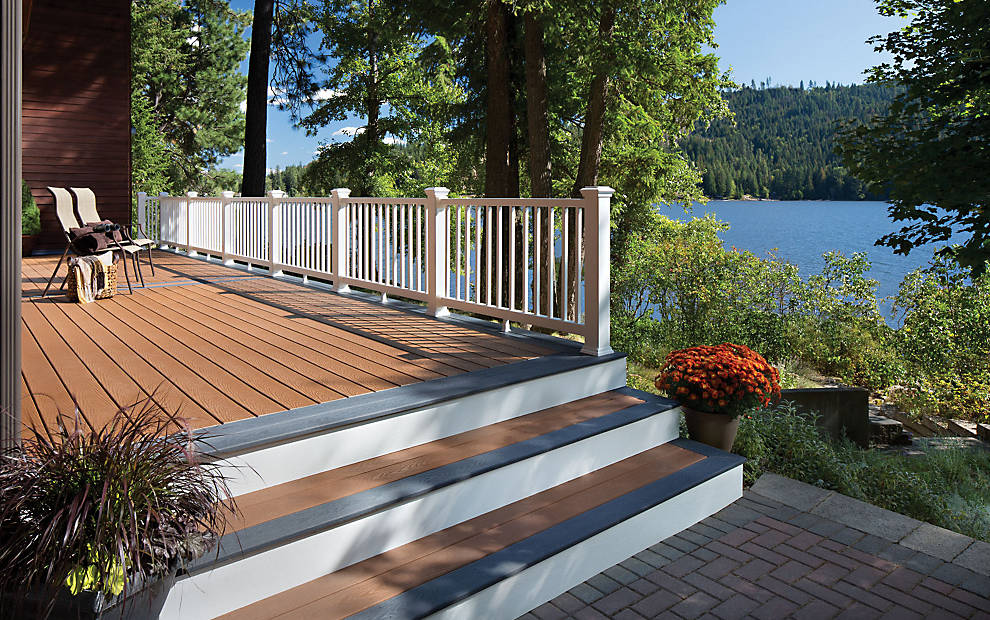Trex Select® Decking in Saddle and Winchester Grey. Trex Select Railing in Classic White. Also featuring: TrexTrim stair risers