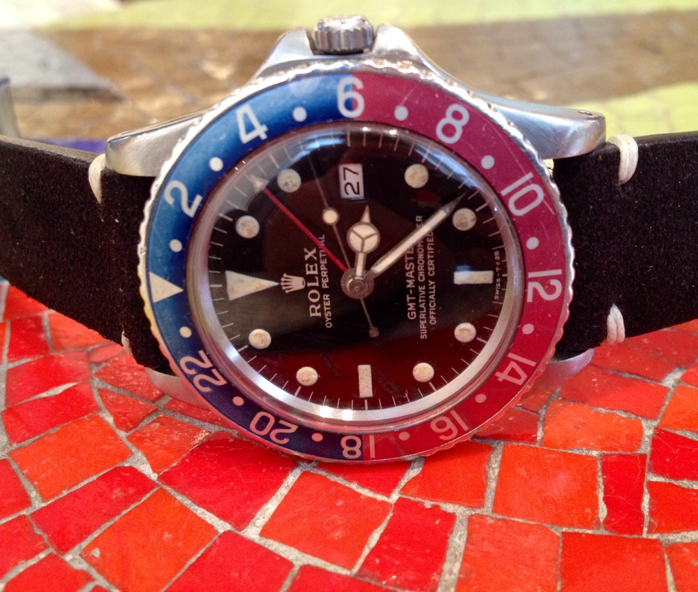 "A Really Cool Rolex GMT Master ""Pointed Crown Guard"" Featuring A Nicely-Faded Pepsi Bezel And A Gilt Dial ($11,200)."