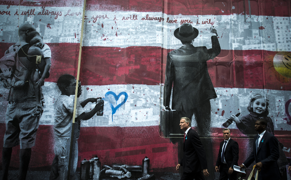 New York City Mayor Bill de Blasio walks back to City Hall from Ground Zero on the 13th anniversary of the 9/11 terror attacks on the World Trade Center.